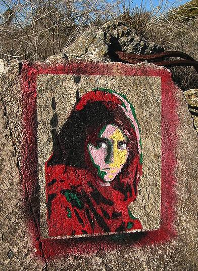 Afhan Girl, refugee Sharbat Gula, painted on rock