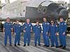 The Discovery crew stands in front of the Space Shuttle that brought them home safely