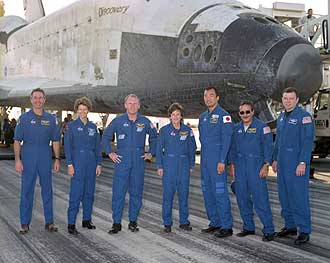 The STS-114 crew stands in front of Discovery at Edwards Air Force Base.