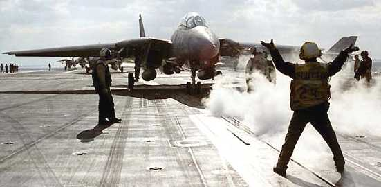F16 aircraft landing on aircraft carrier