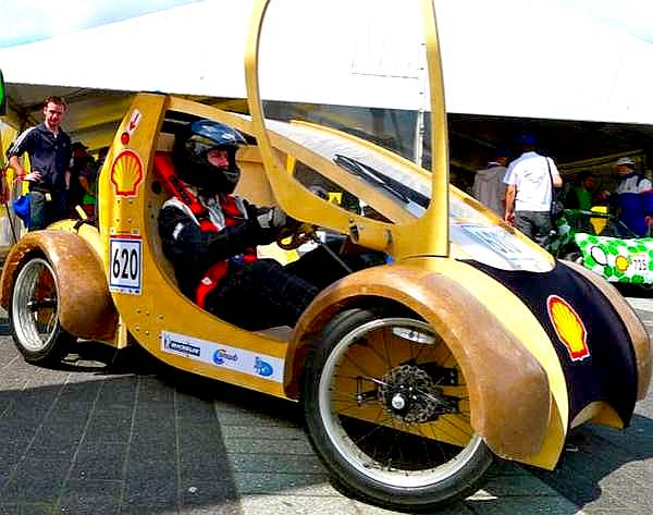 Eco car made of cardboard featuring scissor doors, sponsored by Shell
