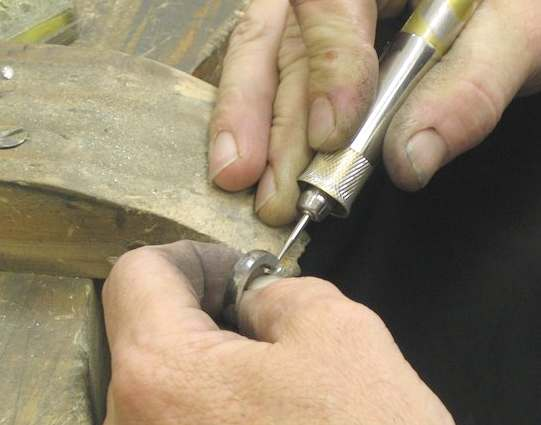 Goldsmith working on a platimum ring