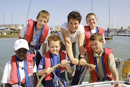 Ellen and kids at helm