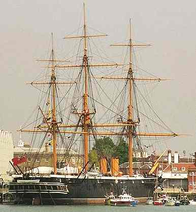 HMS Warrior resting in Portsmouth historic dockyard.