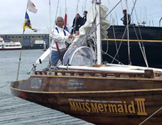Horie at the bow of his small boat, the Mermaid III.