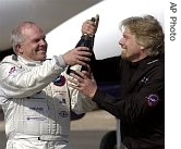 Steve Fossett, left, and Sir Richard Branson celebrate after Fossett landed the GlobalFlyer at the Salina Municipal Airport in Salina, Kansas