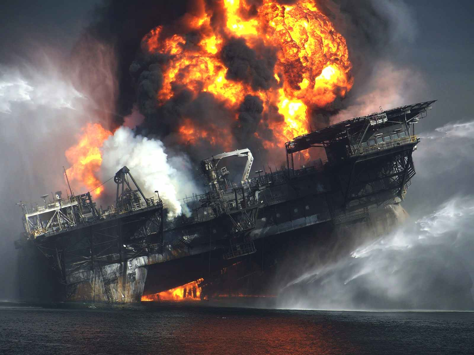BP Deepwater Horizon oil rig collapsing ablaze