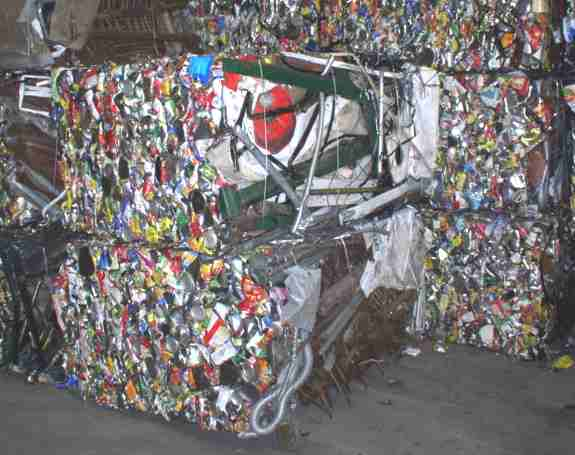 Steel crushed and baled for recycling at Ozark Adventist Academy