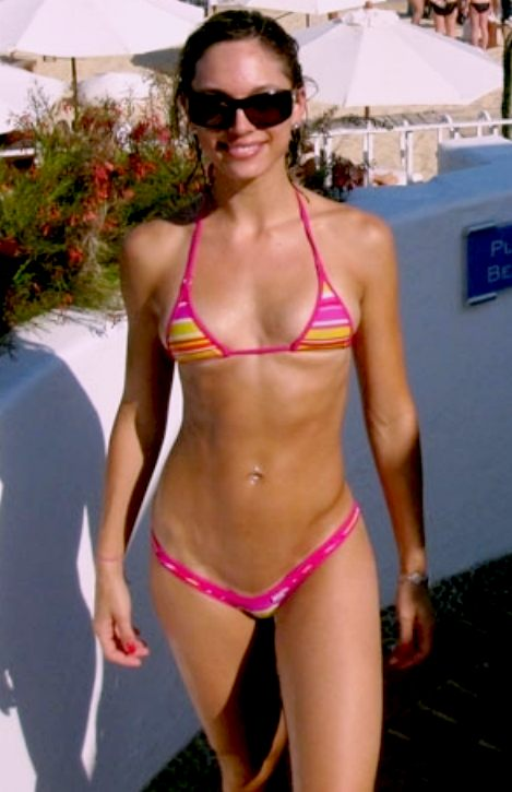 With her slim body and Dark brown hairtype without bra (cup size 32D) on the beach in bikini