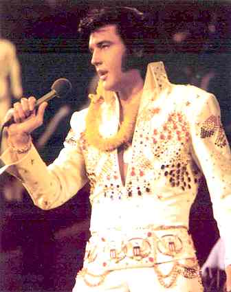 http://www.solarnavigator.net/music/musicimages/elvis_presley_on_stage.jpg