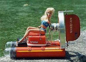 Barbie doll sitting on an electric aerosol model boat from Mexico